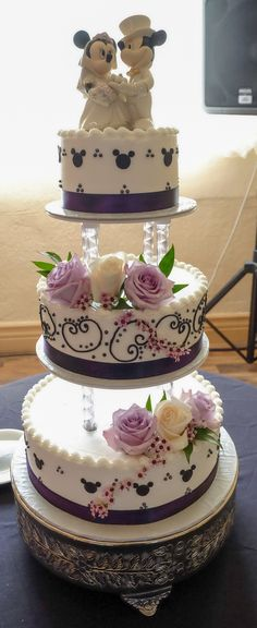 Disney wedding cake.  I love the way this came out and it tasted really good too.  It was buttercream frosting and no fondant.  Yummy!