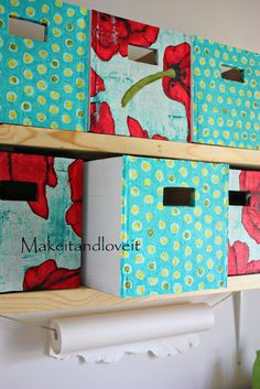 storage boxes completely out of old cardboard boxes covered with a little fabric on the front DIY.... http://www.makeit-loveit.com/2010/04/craft-room-part-1.html