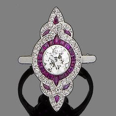 This ring would look amazing with pigeon blood rubies :)