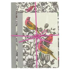 Set of 2 exercise books in Paradiso design with birds in pink, yellow and red on grey cover, exclusive at Paperchase.
