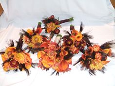 Bridal Bouquets made at Brides request with Burgundy Peacock Feathers, Dahlias, Callas, Strawflowers, Mokara