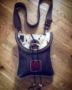 A small Shoulder bag halfway between a belt pouch and a Haversack made from oil tan leather and cow fur Small Cow, Belt Pouch, Small Shoulder Bag, Leather Working, Leather Craft, Tan Leather, Fur, Handmade, Bags