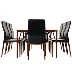 Rosewood Dining Suite By Vestergaard Jensen | From a unique collection of antique and modern dining room sets at http://www.1stdibs.com/furniture/tables/dining-room-sets/