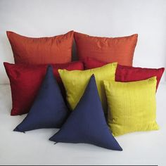 A range of dupioni silk pillow and silk pillow covers in a variety of shades from blues, red, orange, pink and many more. Can be custom made in any size.