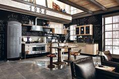 Marchi Group - 1956 - Cucina in Rovere dall'aspetto materico e naturale. Caratterizzata da uno spiccato design e da particolari unici, come il frigorifero alloggiato in una cabina telefonica londinese, la cappa in alluminio patchwork ed il top in cemento trattato.