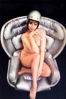Picture represented about space age look, Naked woman with silver helmet with silver rose sitting on the silver leather of Elda...a chair by Joe Colombo that he named for his wife.