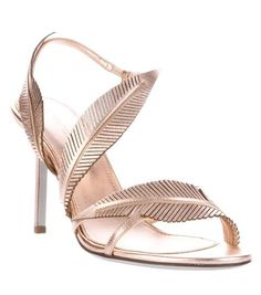 Gold and beige metallic leather sandals from Sergio Rossi featuring an ankle strap, feather detail, round open toe and stiletto heel. you ca...