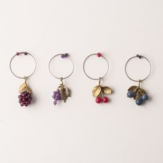 Looking for a great hostess or holiday party gift? These Fruit Wine Charms are a great way to dress up and identify your wine glasses. Cast in bronze and featuring amethyst grapes, garnet raspberry, blue sponge coral blueberries, and red jade cherries this design is now exclusive to Best American Arts. View them @ https://www.bestamericanarts.com/Fruit-Wine-Charms-Set   Crafted by Michael Michaud's Four Seasons Design Studio in Bellmore, New York.