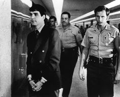 """Charles """"Tex"""" Watson is led back to jail from a courtroom in Los Angeles, Oct. 12, 1971, after he was convicted of seven counts of first-degree murder and one of conspiracy to commit murder in the Tate-LaBianca slayings. Watson, a member of the Charles Manson """"family,"""" was the last of five defendants to be convicted in the slayings."""