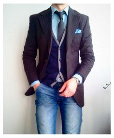Layered look with denim and sweater vest.