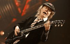 AC/DC's Angus Young has revealed he came up with idea for the band's hit song 'Highway To Hell' while he was sitting on the toilet. Thunder From Down Under, Malcolm Young, Ac Dc Rock, Highway To Hell, Angus Young, News Track, Hit Songs, Washington Dc, Toilet
