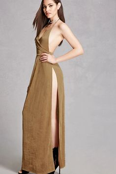 A textured knit maxi dress featuring a metallic sheen, a self-tie halter with a surplice neckline, asymmetrical front pleating, an elasticized waist, and a high side slit. This is an independent brand and not a Forever 21 branded item.