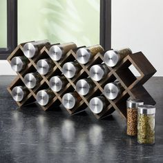 Shop Grey Wash Spice Rack with Stainless Caps. Grey-washed wood crisscrosses a spice rack in a three-in-one design that can stand on its own, be mounted on the wall or tucked into a drawer. Wood Spice Rack, Spice Shelf, Spice Storage, Spice Jars, Hanging Spice Rack, Spice Rack With Jars, Build A Spice Rack, Diy Spice Rack, Smart Storage