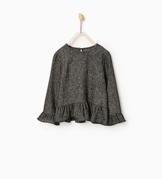 Image 1 of TOP WITH FRILLED HEM from Zara
