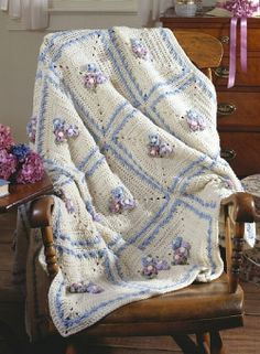 Aubrietia Afghan ~ sharing this downloadable PDF file through my Free Pattern Friday newsletter from Leisure Arts.  Simple & pretty squares with flowers in the middle.   . . . .   ღTrish W ~ http://www.pinterest.com/trishw/  . . . .  #crochet #blanket #throw