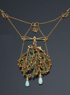 An Art Nouveau gold, plique-à-jour emamel and opal necklace, French, circa 1900. Designed as sprigs of mimosa. With a trace of maker's mark, G.A.