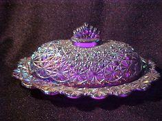 Daisey Amethyst carnival glass butter dish.