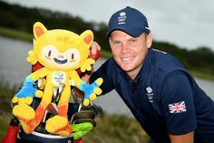 Danny Willett of Great Britain pictured with the Rio 2016 mascot during a practice round at Olympic Golf Course on August 8, 2016 in Rio de Janeiro, Brazil.