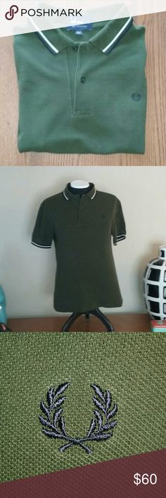 Fred Perry Men's Polo Shirt Lrg Olive Cotton Pique Fred Perry Polo Shirt  •Size: Large  •Color: Olive with Navy & Cream banding on the collar and cuffs. •Materials: Cotton pique Fred Perry Shirts Polos