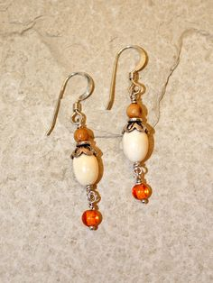 """Handmade ancient mammoth ivory bead earrings, set with sterling silver hooks, and smaller amber bead. Size: 1 5/8""""H Including Clasp  Price: $45.00 -- on ScrimshawGallery.com #jewelry #earring #ivory"""