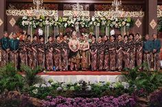 """A lovely lineup of Iput and Novan's bridesmaids, all clad in dark colored kutubaru kebaya and kain batik. Aren't they pretty? Tag your bridesmaids right…"""