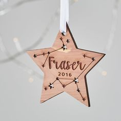 Baby's first Christmas decoration. A scandi themed Christmas decoration for babies on their very first Christmas. Star Personalised Christmas Decoration - Betsy Benn