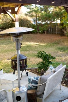 Fall Backyard Porch: use a fire pit and heater to liven up your fall outdoor space.
