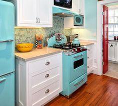 Tiny retro kitchen. I love the teal appliances