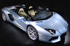 Lamborghini Aventador LP 700-4 Roadster | If you've been longing for an open-air Aventador but didn't want to go Bam and Billy Idol-style on the roof of the coupe, your ride has arrived. At (€300,000; roughly $380,000) adds a two-piece removable carbon fiber roof to the already lust-worthy racer, while retaining the best features from the coupe. Features like a seven-speed gearbox, a 6.5L V12 pumping out 700hp, a 0-62 time of just 3 seconds, and a top speed of 217 mph :D