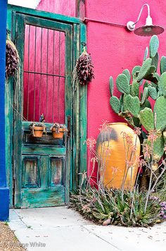 Door in the Barrio. The weathered turquoise color and iron bars paired with oversize Mexican pottery, cactus and hanging chilies scream southwest. Canvas Photo Transfer, Small Room Interior, House Color Palettes, Mexican Home Decor, House Plants Decor, Front Door Colors, Unique Doors, Mexican Style, Rustic Elegance