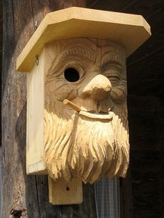Carved birdhouse.