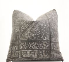 This pillow cover is sewn from a vintage piece of a Chinese, handmade, batik textile. The base is a medium gray with lighter gray batik pattern.