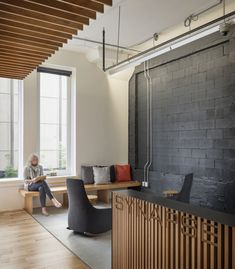 I like the wood accents on the ceilings and the grey with accent colors.  EWD  A more rustic modern look  Inside Synapse's Seattle Offices