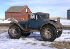 This 1931 Ford 68B convertible is said to be one of two modified in 1941 for deep snow mail delivery duty in Montana. It has modified fenders, tractor tires, and a truck differential.  AWESOME!!! Constructeur Automobile, Monster Car, Monster Trucks, Vintage Trucks, Old Trucks, Muscle Cars, Car Dealerships, Tractor Tire, Mail Delivery