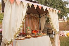 dessert pavilion. Love how they used this gazebo to hold the chandelier.