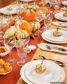 "Macy's Thanksgiving Table Setting | Martha Stewart Living - The beautiful antique wooden table with just a simple runner can be describe as ""formal rustic."""