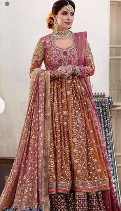 Shop Pakistani kalidaar heavy embroidered lehenga at our online store For More Details Call Whatsapp Us Now Asian Bridal Dresses, Latest Bridal Dresses, Indian Bridal Outfits, Pakistani Wedding Dresses, Indian Dresses, Walima Dress, Bridal Collection, Dress Collection, Mehndi Dress