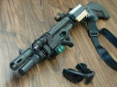 Remington 870 with a ton of goodies.