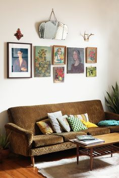 vintage furniture, pillows and gallery wall of thrift store paintings and art history prints.