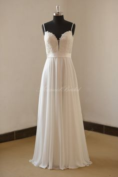 Deep V neckline beach/destination wedding dress with Spaghetti Straps    Fabric: Chiffon  Embellishment : Lace  Silhouette:A line    Back: Zipper
