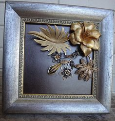 7x7 shabby chic silver distressed frame with a 4.5x4.5 opening has vintage jewelry arranged on pearlized black leather. This is a OOAK item,