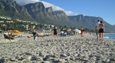 Camps Bay, Cape Town, South Africa. Camps bay is a popular beach in Cape Town. It has a beautiful mountain backdrop called the 12 Apostles. There are some trendy restaurants and bars Camps Bay you can enjoy in as well. #campsbay #capetown #africa #southafrica #travel #surf #beach #holiday #relax