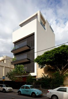 Amazing White Wall, Modern Balconies And Wide Glass Windows House Front View From The Road Side
