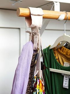 Just a few inches of storage is all it takes to gather what would otherwise be awkward storage clutter in a drawer or on a shelf. Here, a fabric holder with loops offers a convenient storage spot for hanging belts and scarves. /
