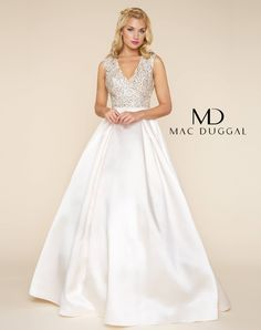 Capture the attention of everyone in the room wearing this vintage style Mac Duggal ball gown. A plunging sweetheart neckline shines in brilliance as AB stone and beading give it that extra shine that just won't go ignored. The plunging neckline leads  into the v-open back for a dramatic effect. In a geometric pattern, embellishments easily flow throughout the entire bodice. A gorgeous taffeta skirt flares out  and features a horsehair trim at the bottom to give this ball gown skirt a little…