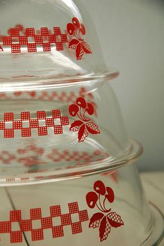 "The 322 Rimmed Nesting bowls titled ""Red Cherries"" debuted along with ""Blue Ribbon"" in 1992, according to corellecorner.com."