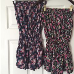 Two Strapless Floral Patterned Rompers Bundle These two super cute rompers are in EUC. Have been worn a number of times, however are still in great condition. They were both purchased from Delia's years ago. Both have different floral patterns on them (pic 4). Both contain pockets & are strapless. Both size L! These two for $20 total! Such cute rompers for both spring & summer! Delia's Tops