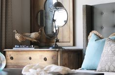 Very pretty room.  Love the soft turquoise, gray and beige.