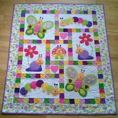 Take your favorite children's material and make it into a quilt accent piece. This Bug Quilt did just that! Make an applique of a character in the material. Love it! DLW