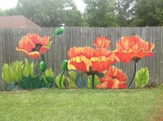 Painted flowers on privacy fence!  Colir year-round, yes please!
